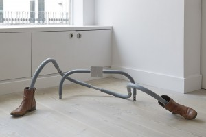 Do I Look Alright?, 2015, retrieved foam coated metal 'abs' frame, boots, 38 x 122 x 61 cm