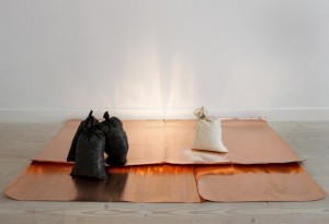 Khanlar Gasimov, All happens in your presence (2012) Poetry recited canvas, copper, crushed light bulbs, coal 205 x 105 x 60 cm