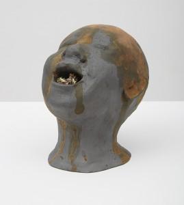 Una testa e un universo senza titolo 2, 2015, bronze, 20 x 20 x 35 cm