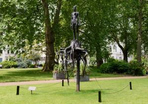 Aron Demetz, Heimat, 2010, 400 x 140 x 133 cm, St. James's Square Gardens, London, SW1Y 4JS