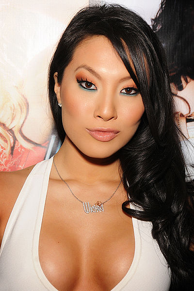Porn star Asa Akira in low cut dress