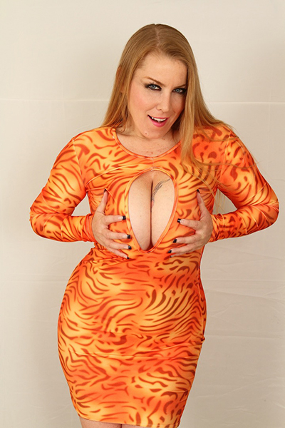 Desiree Deluca orange catsuit pushing boobs together
