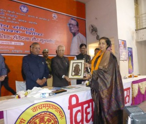 Receiving an award from Governor of West Bengal KN Tripathi