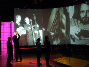 Giant video screens inside Rockheim