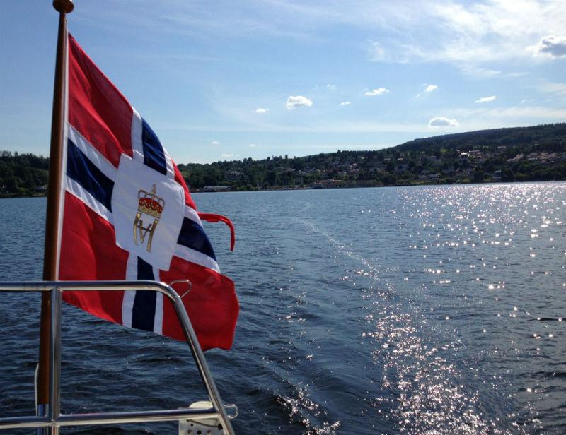 Norwegian flag over the water