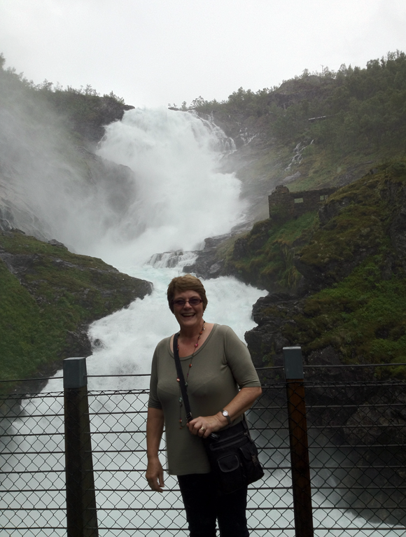 Mum in front of the Kjosfossen waterfall