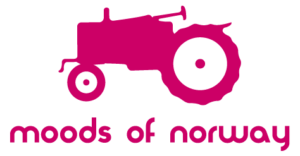 pink tractor logo