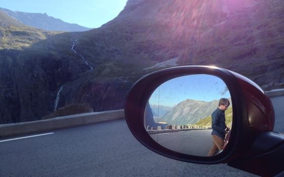 Chris in the car mirror