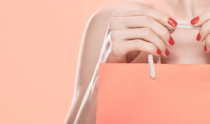 personal shopper - woman carrying a high end shopping bag