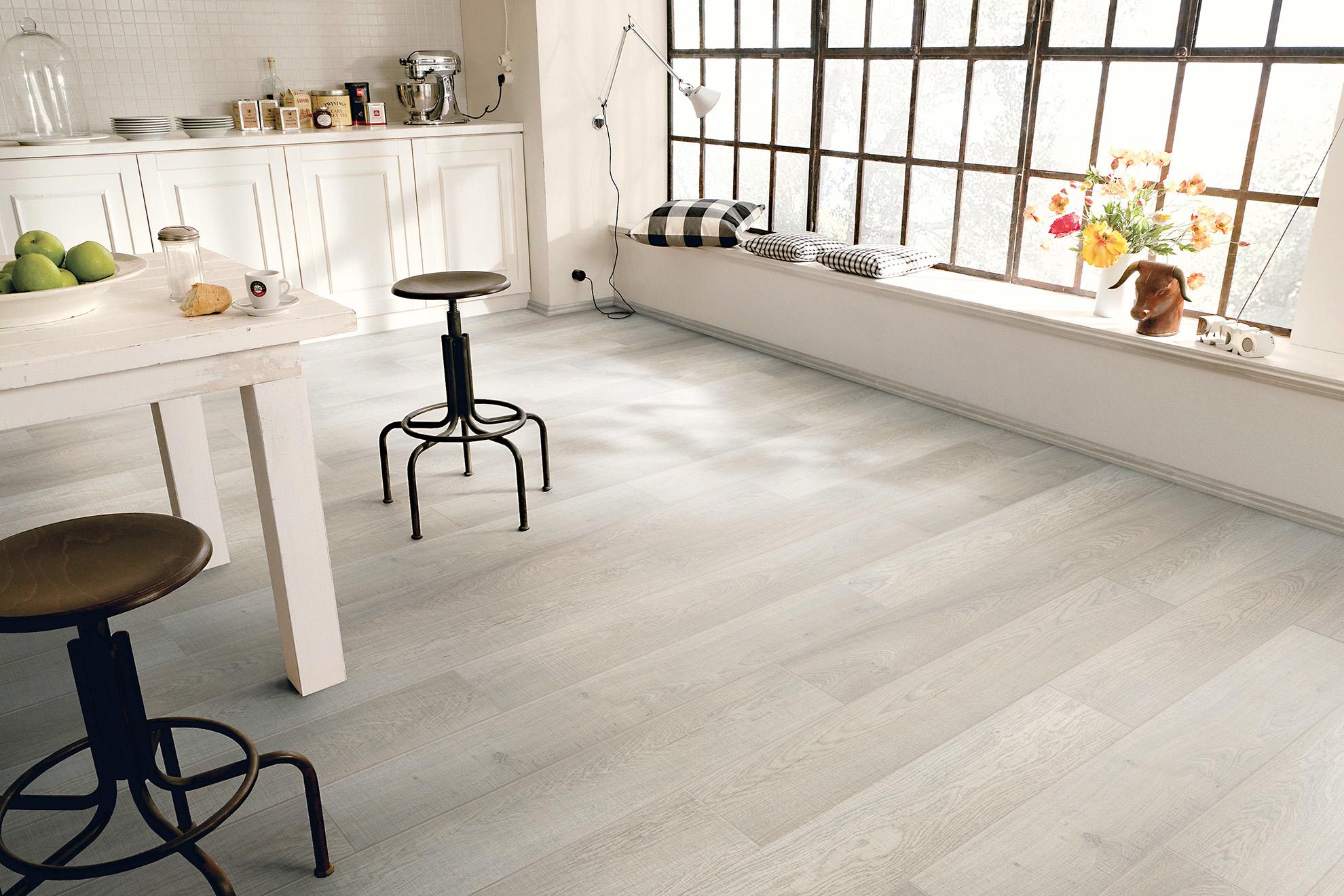 Laying tile effect laminate flooring