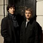 Benedict Cumberbatch as Sherlock Holmes and Martin Freeman as John Watson at the door of 221b Baker Street