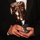 Steven Moffat with Sherlock's BAFTA for Best Drama