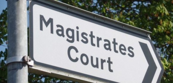magistrates-sign-pointing-right-640x441