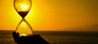 glass egg timer sunset
