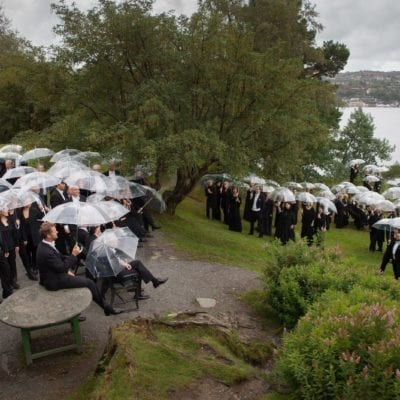 Bergen Philharmonic Outside with Umbrellas [credit Oddleiv Apneseth]