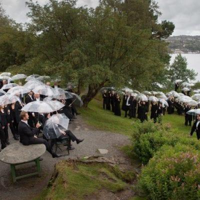 Bergen Philharmonic Outside with Umbrellas [credit Oddleiv Apneseth]