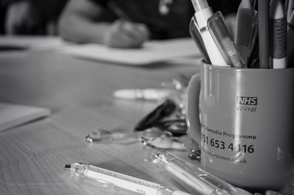 An image showing a mug filled with pens in focus representing the theme of ways to stay creative