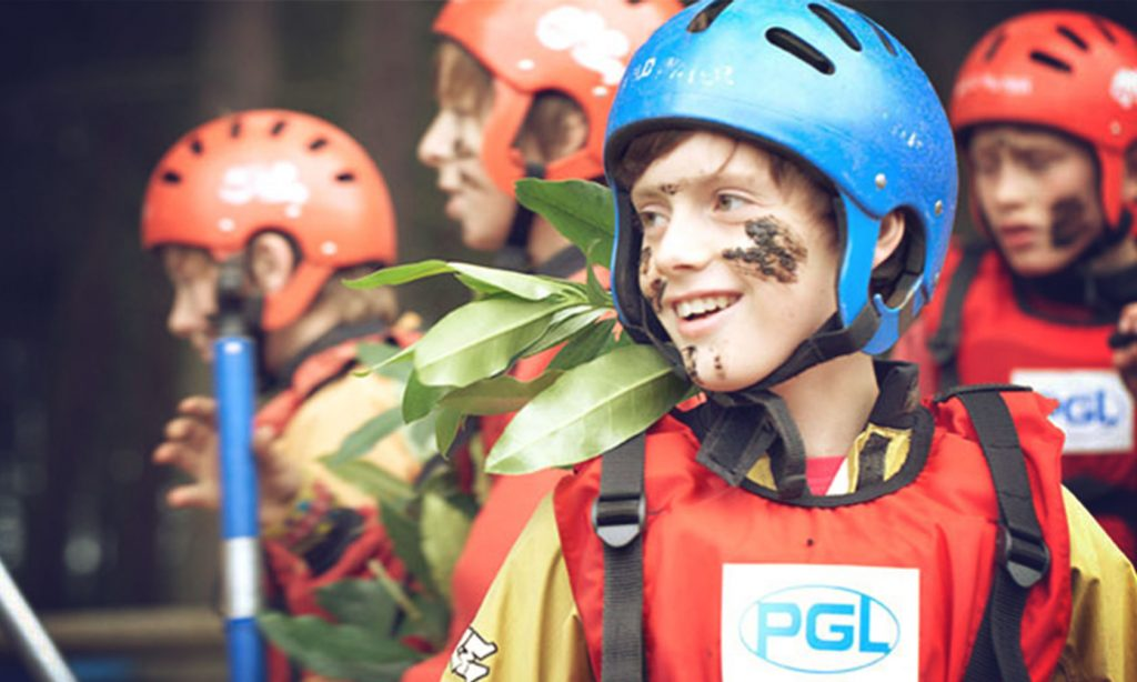 PGL boy with mud on face