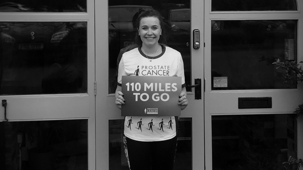Becca Holding 110 miles sign