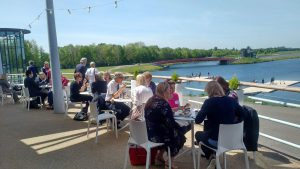 Delegates networking in the sunshine on the balcony
