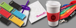 a range of promotional gifts on a grey background