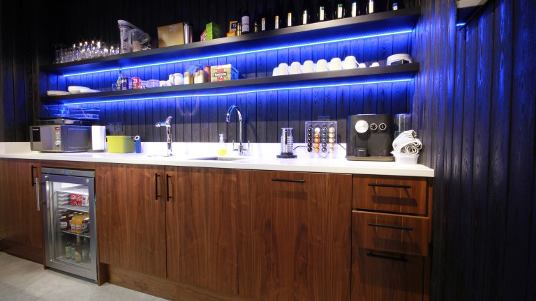 Office kitchen with blue lighting