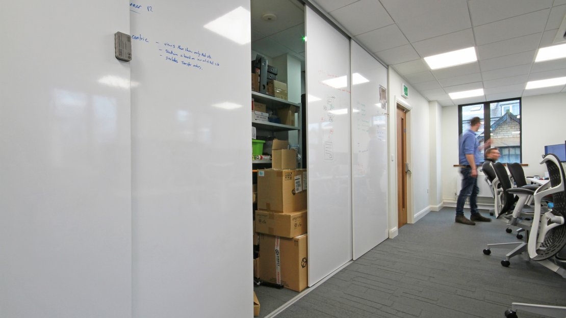 Whiteboard walls with storage area behind