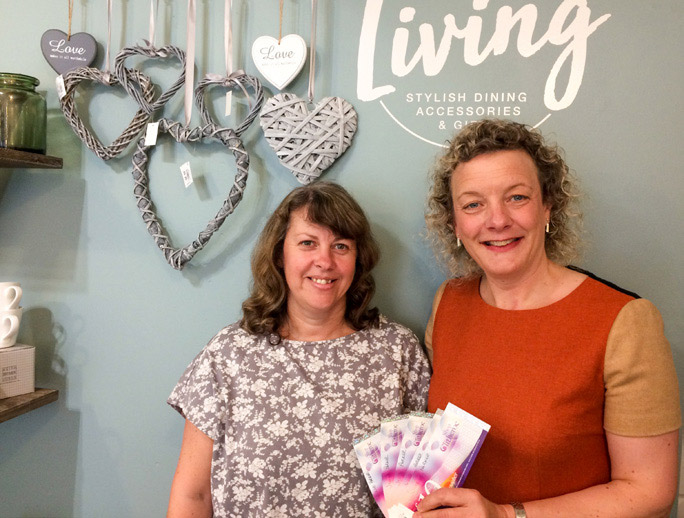 Julie Parker (right) receives her Shop Clitheroe vouchers from Audrey Spencer at gift shop Valley Living