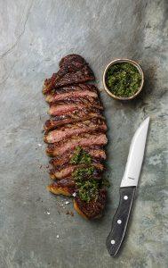 Sliced grilled beef barbecue Striploin steak with chimichurri Amefa Cloud Cart Bira Direct