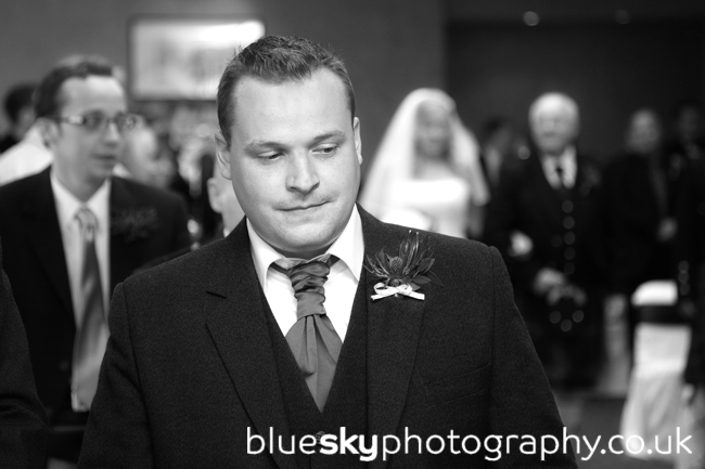 Dave, waiting for Emma coming down the aisle