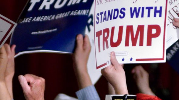 Donald Trump rally crowd holding placards