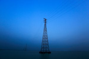 https://s3-eu-west-2.amazonaws.com/cd.darkblue.staging/content/uploads/2020/05/20092508/PHX86J_Electricity_pylons_in_Bhola.jpg