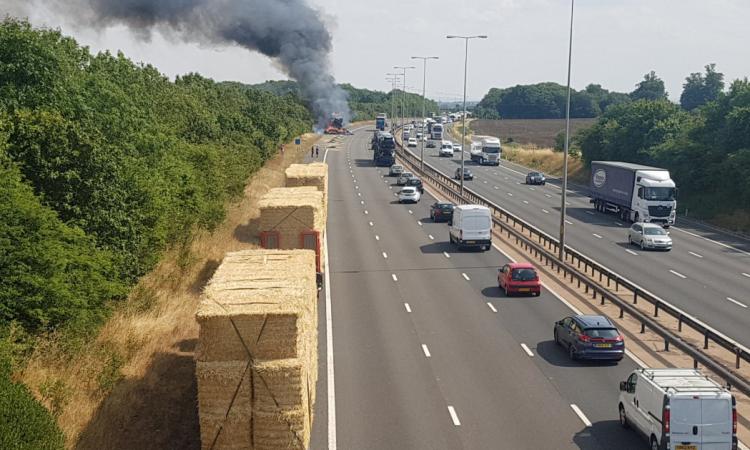 Lorry transporting bales goes up in smoke on UK motorway