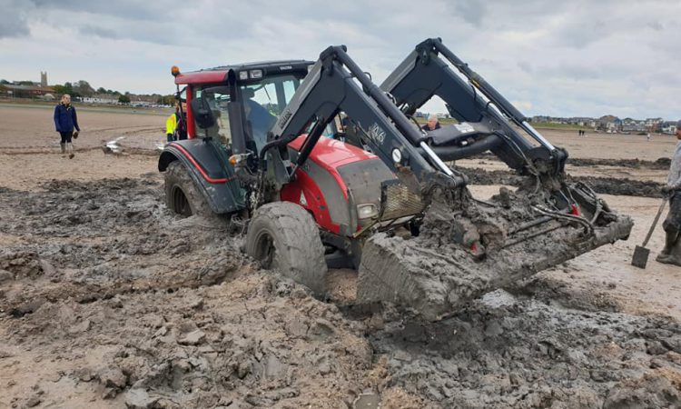 Tractor stuck on Exmouth beach for 2 days pulled free