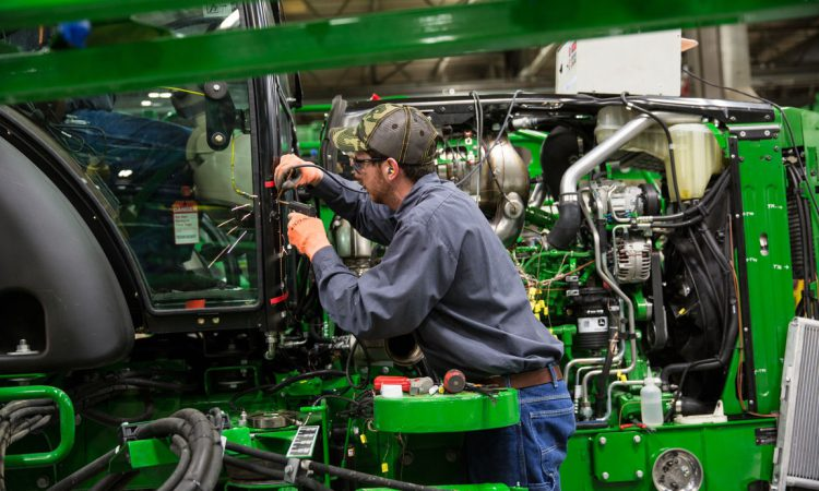 John Deere to cut back production in some factories
