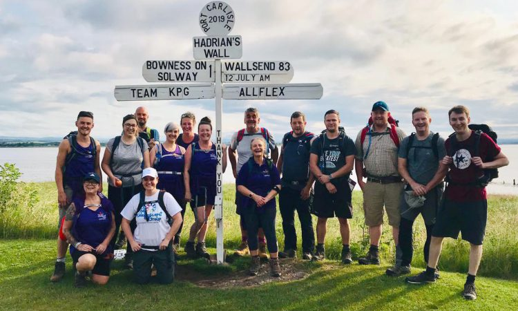 Ear tag firm staff take on Hadrian's Wall for rural mental health charity