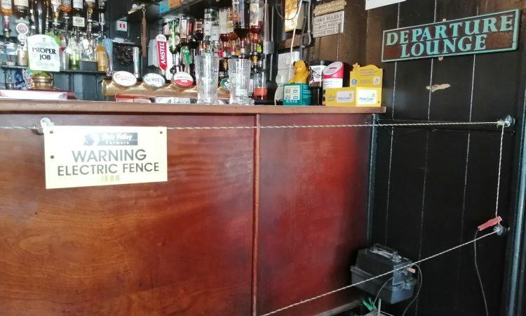 Pub installs electric fence to ensure social distancing at bar