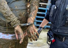 Man arrested after falling 'neck-deep' into slurry pit after police chase