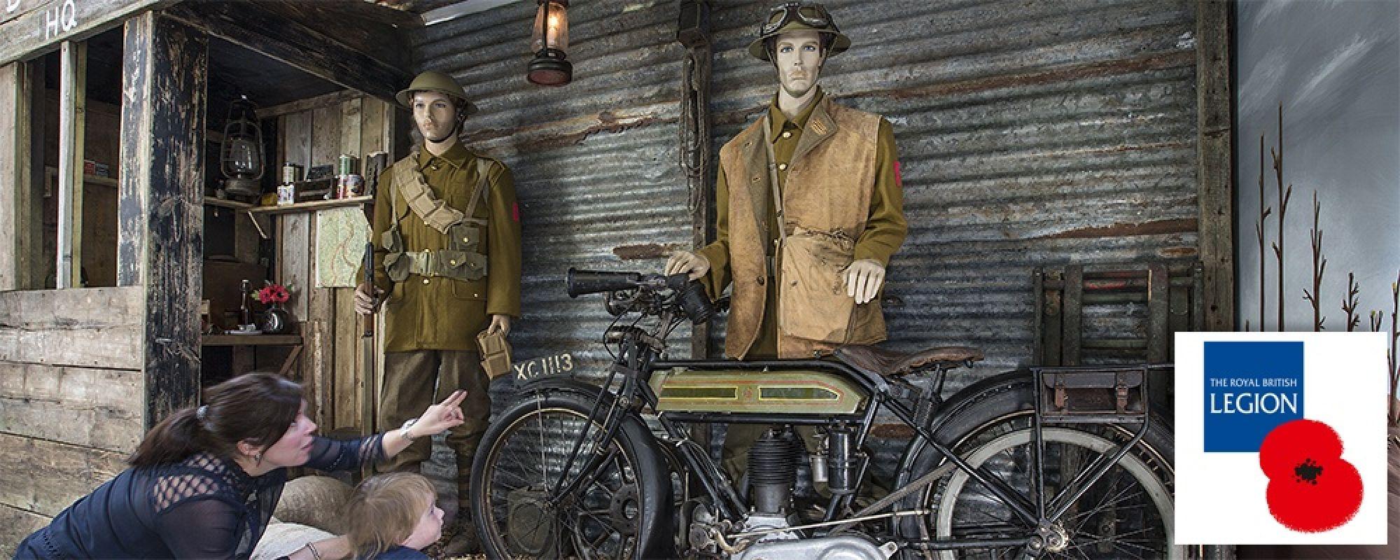 two customers lookat Royal British Legion display in Lakeland Motor Museum.