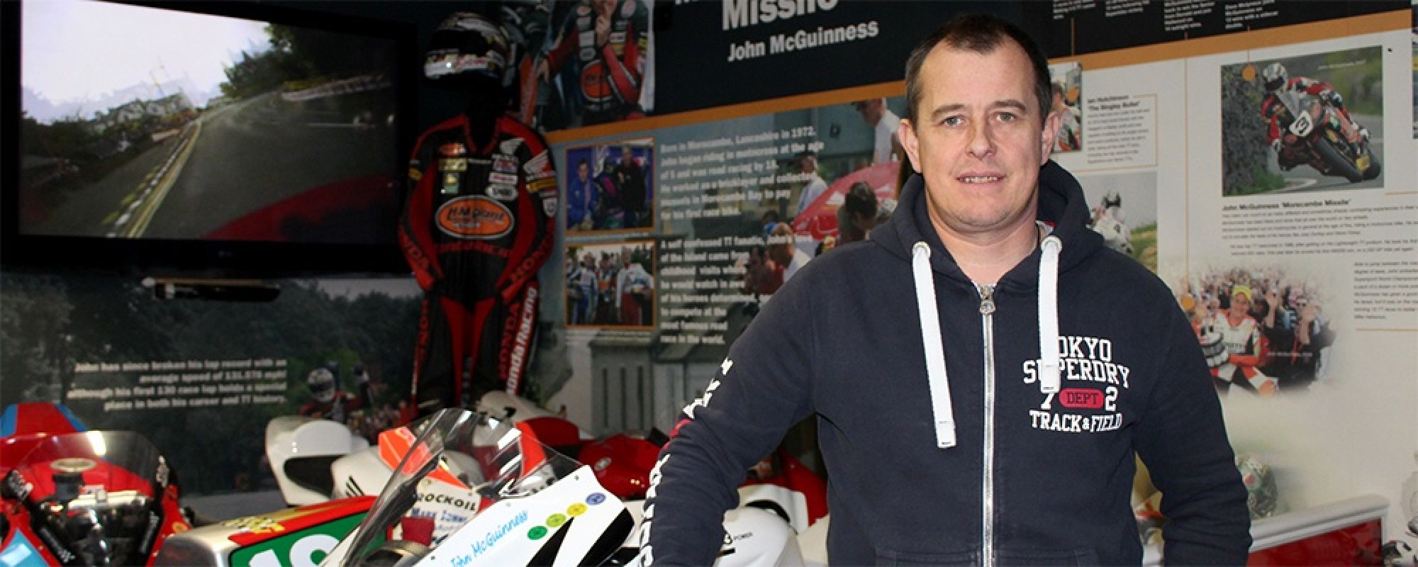 John McGuiness in front of the Isle of Man TT exhibition