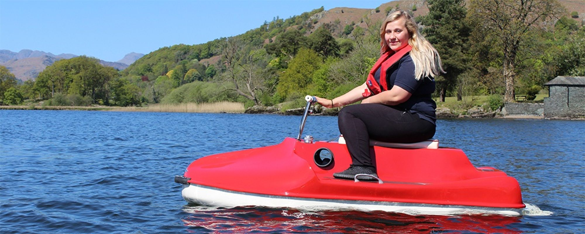 Photo of the restored scooter on Lake Windermere