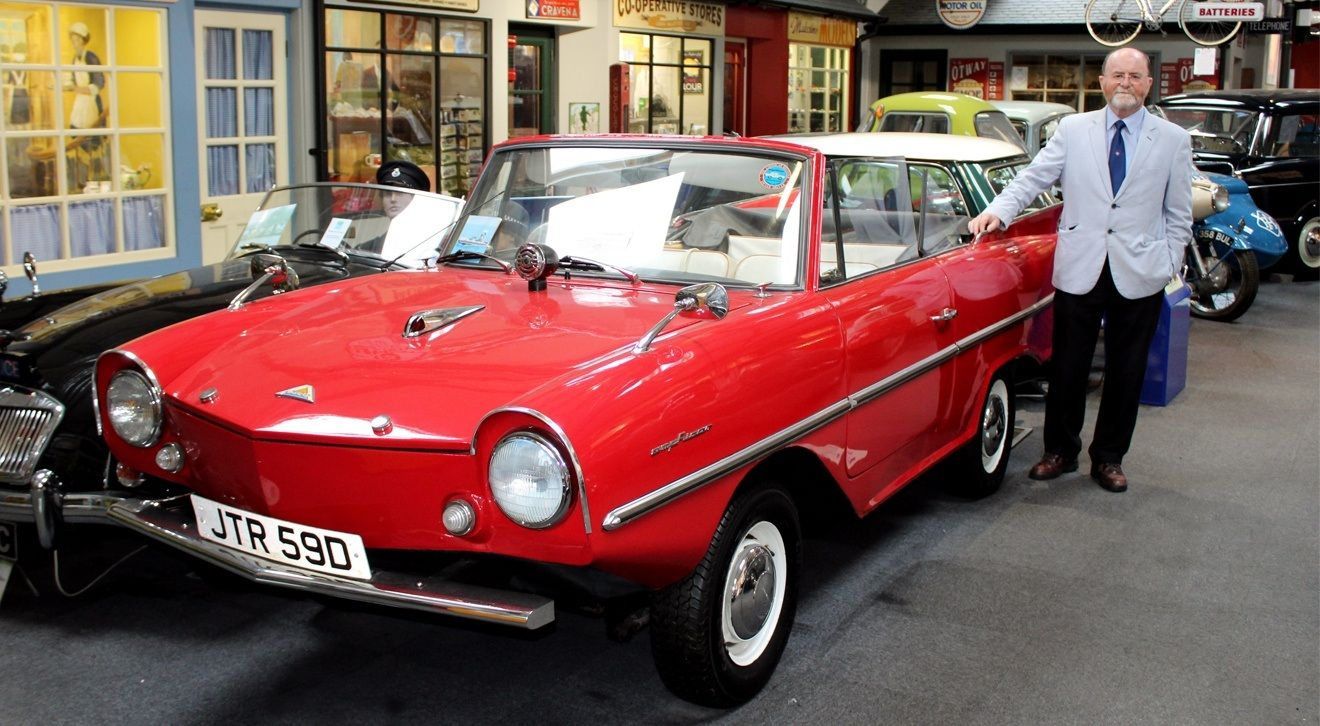 Bill Bewley, Chairman of the Lakeland Motor Museum standing with the Amphicar at the museum.