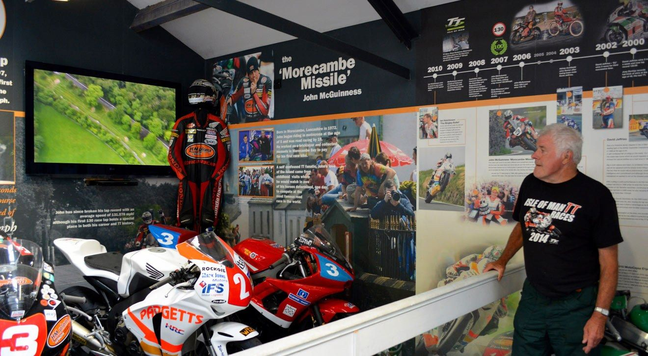 A customer enjoys the Isle of Man TT exhibit at the museum