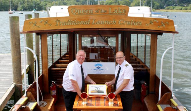 Dave Windsor and Skipper, Colin Greatorex, with Queen of the Lake's 70th birthday cake