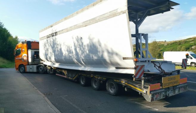 A section of the new ship being transported to Lakeside Pier