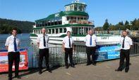 Five trainee masters of MV Swift standing in front of MV Swift