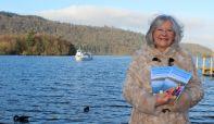 Maureen Fleming with Jim's guidebook