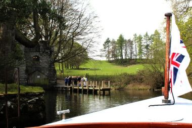 A traditional launch approaching Wray Castle Pier