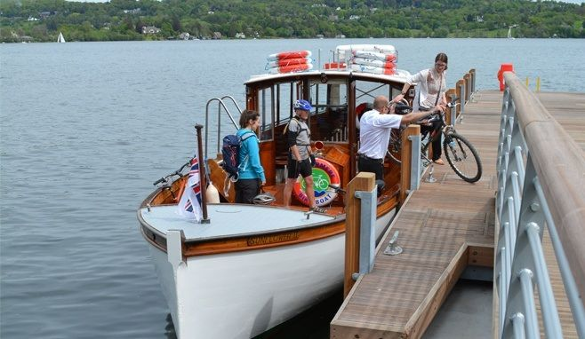 Cyclists arriving at Bark Ban Jetty on the Windermere Bike Boat