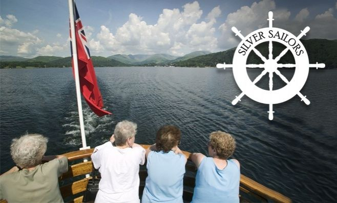 Four pensioners on the back of a cruise with the silver sailors logo
